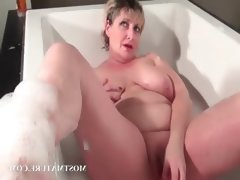Mature tramp dildoes pussy..