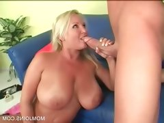 Slutty milf gives tit job on..