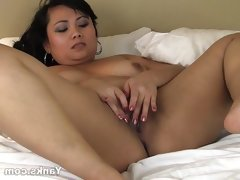 Asian thea masturbating her..