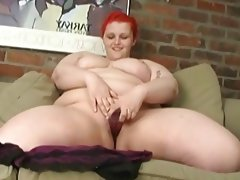 Red head bbw sticks dildo in..