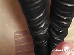 Coating her leather boots