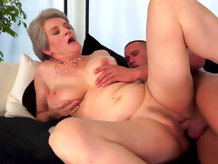 Granny is sucking a horny..